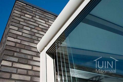 Lagere stookkosten dankzij een overkapping met glazen schuifwanden